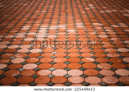 cement brick floor background.patterned paving tiles. - stock photo