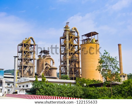 cement factory on blue sky background - stock photo