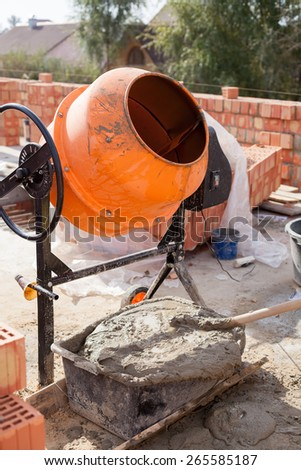 Cement mixer at a construction site - stock photo
