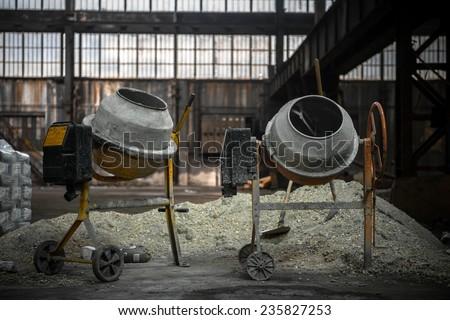 Cement mixer at a construction site closeup - stock photo