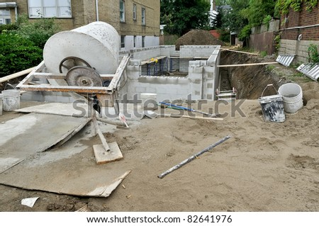 cement mixer on construction site - stock photo