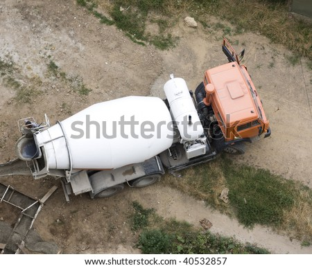 Cement Mixer Truck at work above - stock photo
