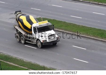 Cement mixer truck on the street - stock photo