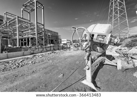 Cement or mortar is inside cement mixer. - stock photo