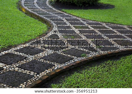 Cement path way walk way on lawn with grass, y shape, curvy shape - stock photo