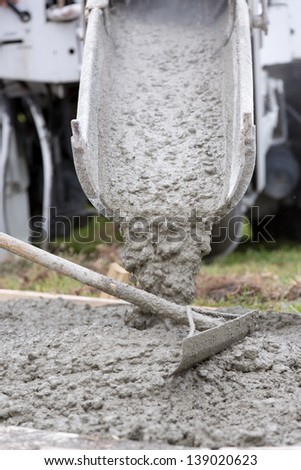 Cement Pour Worker's pouring a cement patio - stock photo
