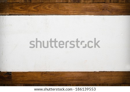 cement wall and wood frame for the background. - stock photo