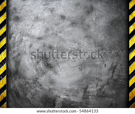 cement wall with metal warning stripe - stock photo