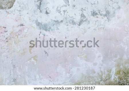 Cement wall with traces of crumbling plaster and moss. textural composition - stock photo