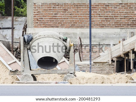 cements mixer machine or Old cement mixer used in construction. - stock photo