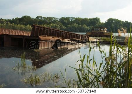 Cemetery abandoned ships, radioactive metal. Pripyat. 2006 - stock photo