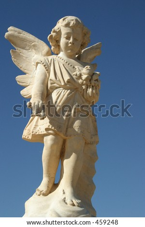Cemetery Angel with a clear blue sky - stock photo