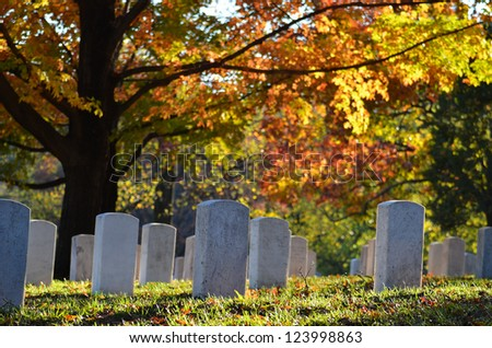 Cemetery in autumn - stock photo