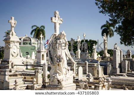 Cemetery of Santiago De Cuba decorated with beautiful white marble sarcophagi and statues - stock photo