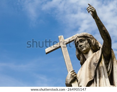 Cemetery statue in Italy, made of stone - more than 100 years old - stock photo