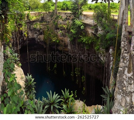 Cenote San Lorenzo Oxman near Valladolid, Mexico. lovely cenote with deep turquoise waters - stock photo