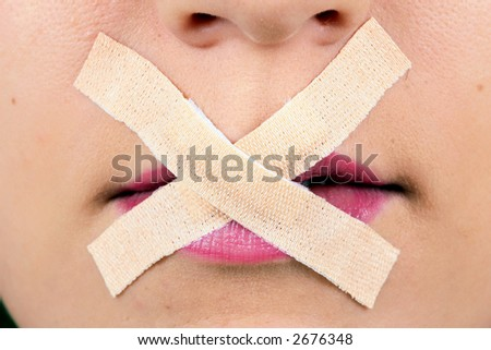 Censored Beauty a censored mouth with tape over the lips. - stock photo