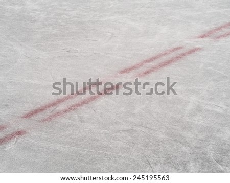 Center red line of an ice hockey rink, winter sport background - stock photo