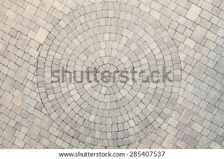 Center view of patio pavers circle design overhead view. Showing well detail  cutted edges to match to the circle design - stock photo