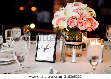 Centerpieces on a table at wedding reception - stock photo