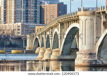 Central Avenue Bridge and St. Anthony Falls in Minneapolis - stock photo