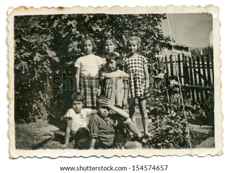CENTRAL BULGARIA, BULGARIA,- CIRCA 1955: A group of children in a summer garden. Note: slight blurriness, better at smaller sizes - circa 1955 - stock photo