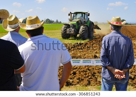 CENTRAL ITALY- JUNE 23:: Agricultural fair with free admission, including displays of tractors and agricultural machinery, crowded with farmers and landowners. June 23, 2013 in Latina, Central Italy. - stock photo