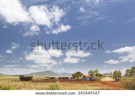 Central Kenyan Farm Landscape on the main road between Mombasa and Nairobi, Kenya. - stock photo
