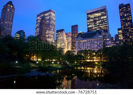 Central Park and New York City skyline at dusk, USA - stock photo