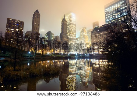 Central Park and New York City skyline at mist - stock photo