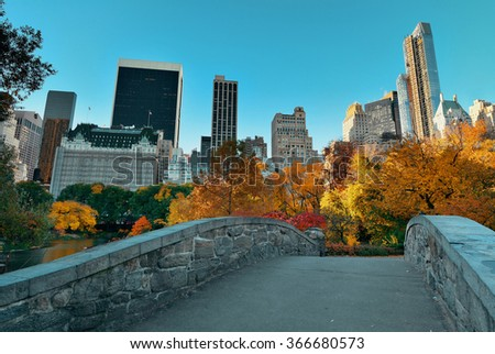Central Park Autumn with bridge in midtown Manhattan New York City - stock photo