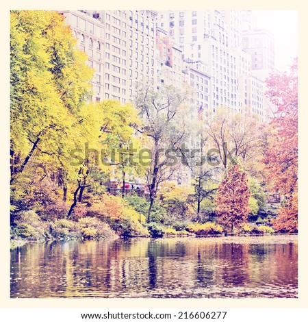 Central Park in autumn and Manhattan skyscrapers with Instagram effect filter - stock photo