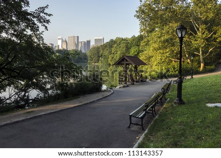 Central Park, New York City at the lake in the early morning in summer - stock photo