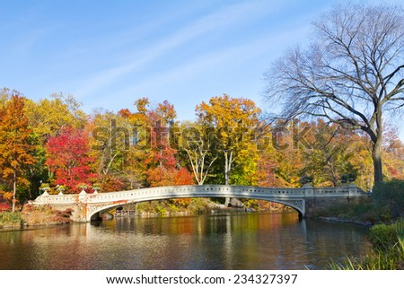 Central Park, New York City - Scenic view of Bow Bridge during the colorful Fall season - stock photo