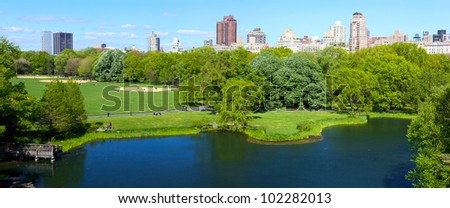 Central Park panorama with Manhattan skyscrapers over Turtle Pond, New York - stock photo