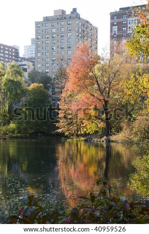 central park pond in new york city on the upper west side by the north field in autumn with colorful trees and leaves - stock photo