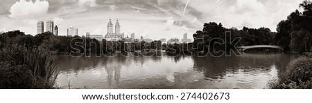 Central Park Spring with skyline panorama in midtown Manhattan New York City - stock photo