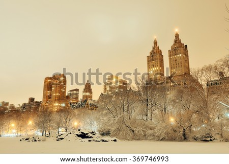 Central Park winter at night with skyscrapers in midtown Manhattan New York City - stock photo