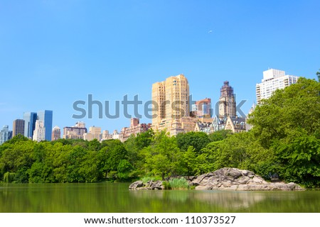 Central Park with Lake and Manhattan skyscrapers, New York - stock photo