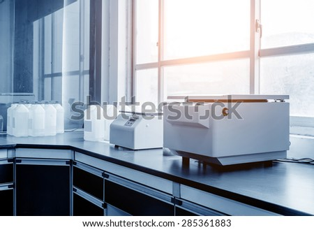 Centrifuge in the modern medical laboratory - stock photo