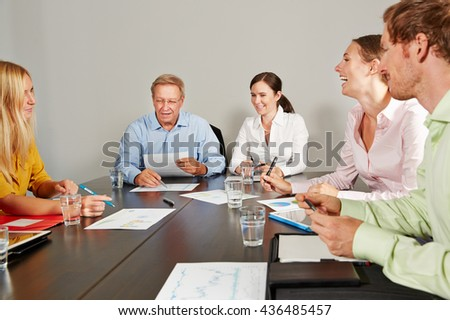 CEO leading business team meeting in conference room - stock photo