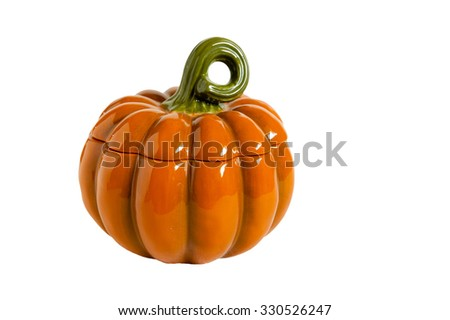 Ceramic Bank in the form of a pumpkin with a lid , against white background - stock photo