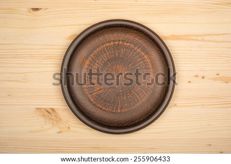 Ceramic bowl on wood background. Top view - stock photo