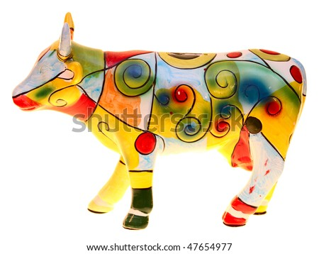 Ceramic cow painted colors. - stock photo