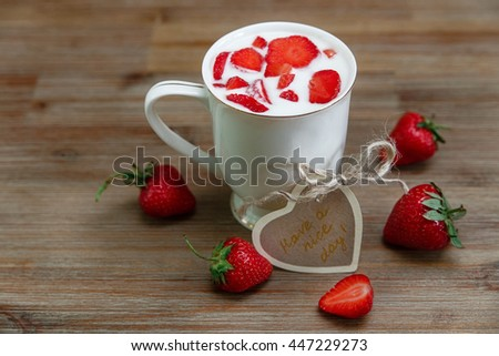 Ceramic Cup of Milk,Red Fresh Strawberries,Wish Card on the Wooden Background.Breakfast Organic Healthy Tasty Food.Cooking Vitamins Ingredients.Summer Fruits.Selective Focus - stock photo