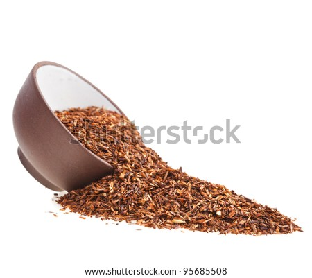 ceramic dish with healthy herbal tea loose rooibos leaves isolated on white background - stock photo