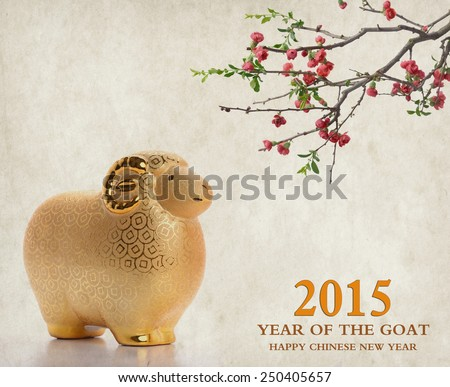 Ceramic goat souvenir on old paper,2015 is year of the goat - stock photo