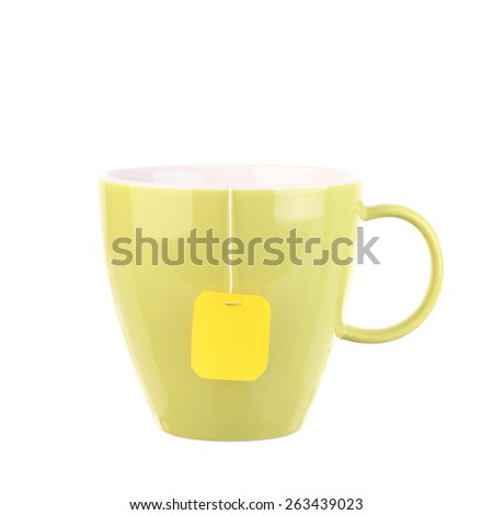 ceramic green cup with tea bag label isolated on white - stock photo