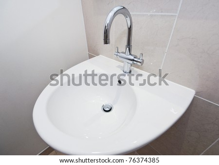 ceramic hand wash basin with modern fixture - stock photo