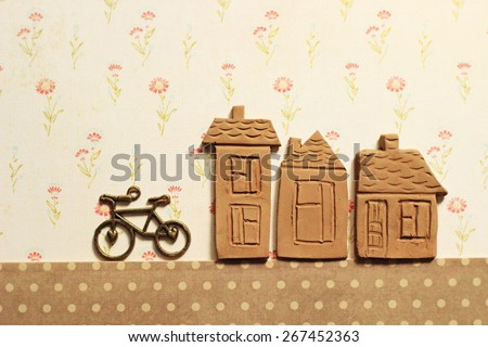 ceramic houses and bicycle  - stock photo